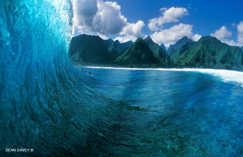 water view of a tubing wave at Teahupoo, Tahiti
